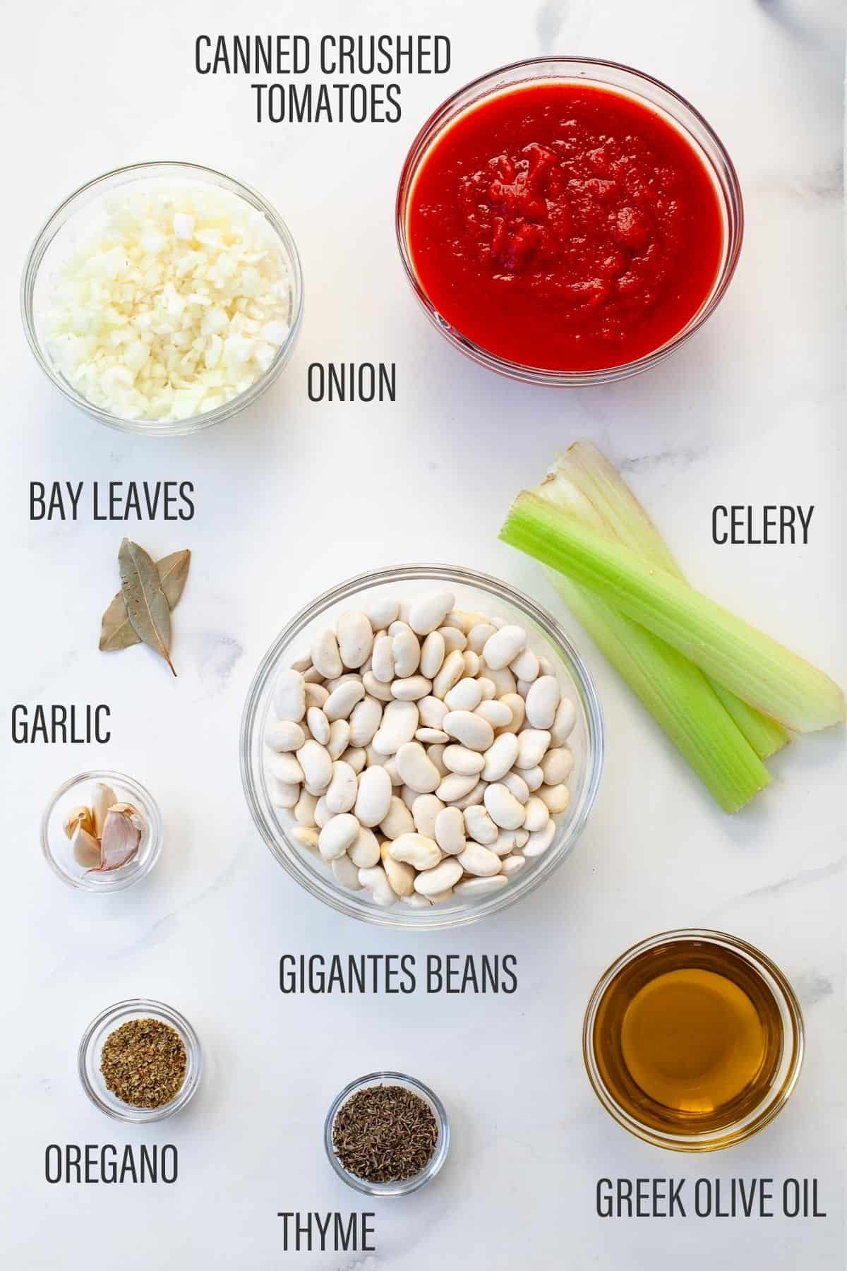 list of slow cooker greek baked beans ingredients white counter tomatoes gigantes beans bay leaves garlic