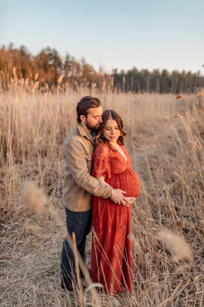 3rd trimester recap and recommendations kara lydon nutrition husband pregnancy photoshoot red dress new hampshire