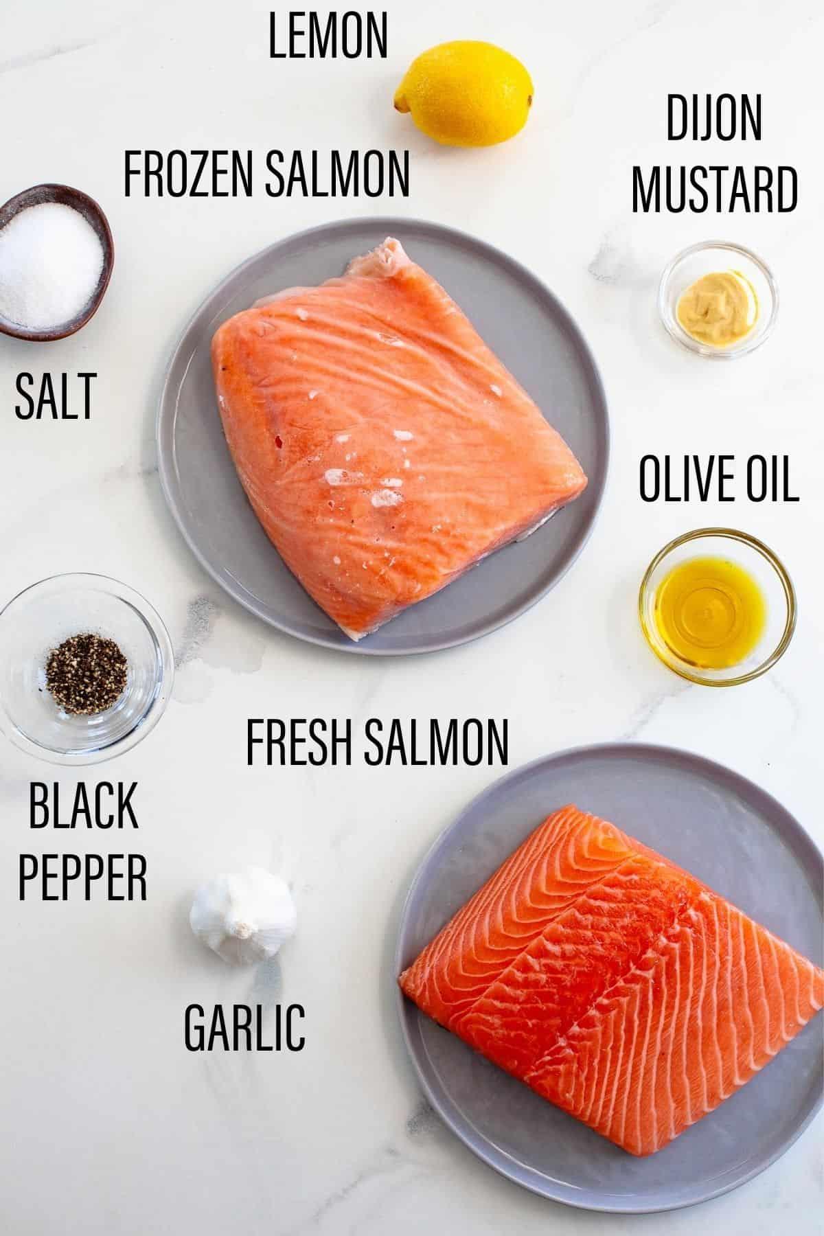 ingredients for air fryer salmon fresh frozen salmon fillet lemon olive oil on white surface