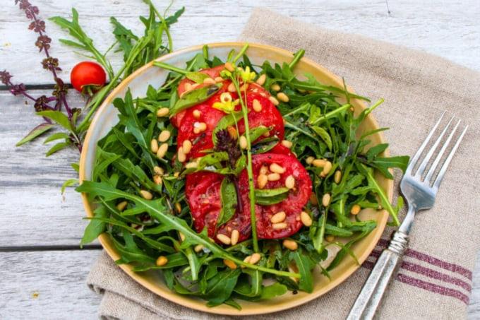 Farmer's market tomato and arugula salad with pine nuts